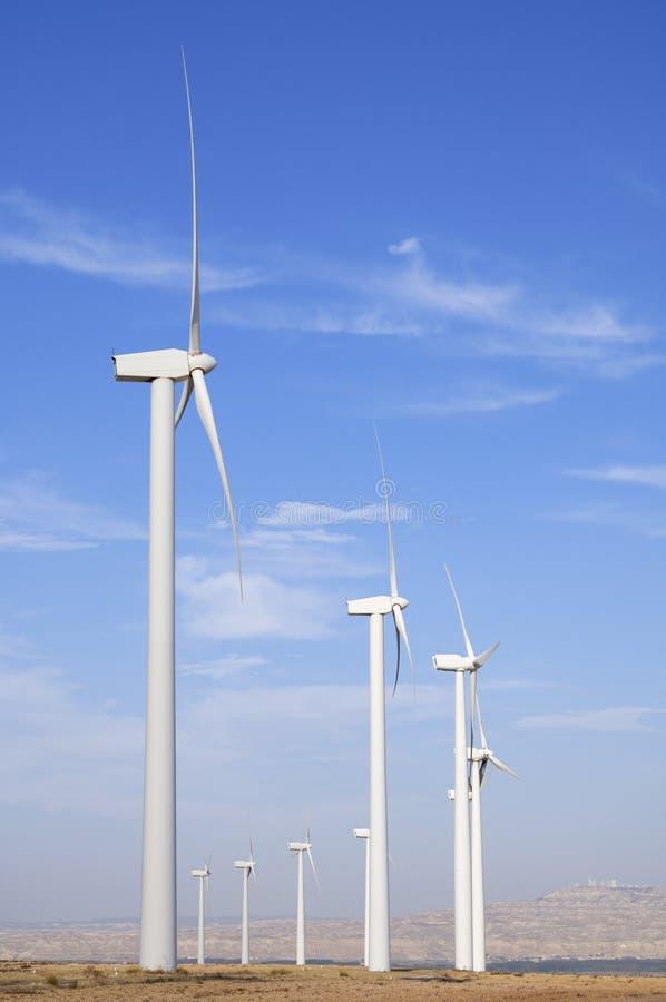 Windmills lined stock photo