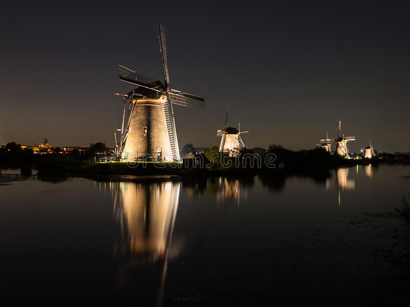 Windmills lit at night royalty free stock photography