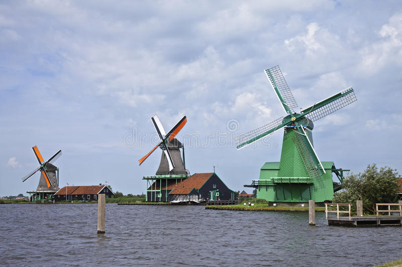 Windmills, Netherlands. Very old authentic windmills in a row in Zaandam or Zaanse Schans, Neterhlands, Holland, Europe. Very popular with the tourists and old stock photography
