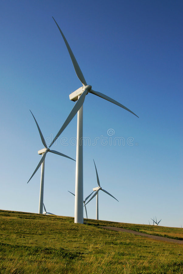 Windmills on prairie stock image