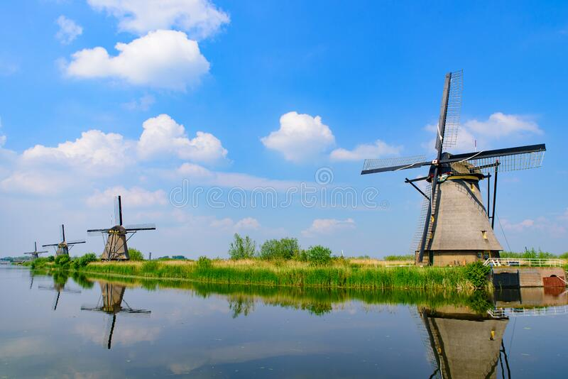 The windmills and the reflection on water in Kinderdijk in Rotterdam, Netherlands. The windmills and the reflection on water in Kinderdijk, a UNESCO World royalty free stock photography