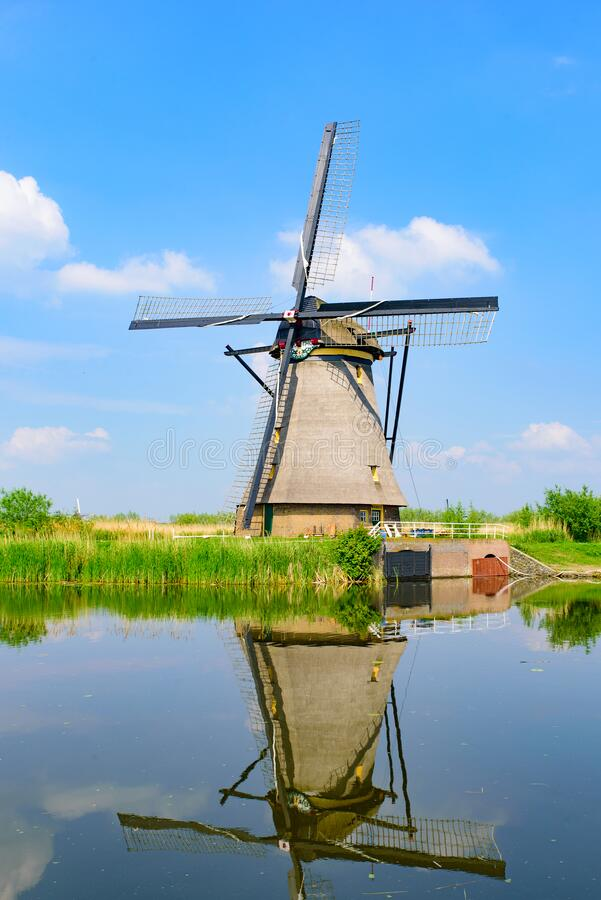The windmills and the reflection on water in Kinderdijk in Rotterdam, Netherlands. The windmills and the reflection on water in Kinderdijk, a UNESCO World stock photography