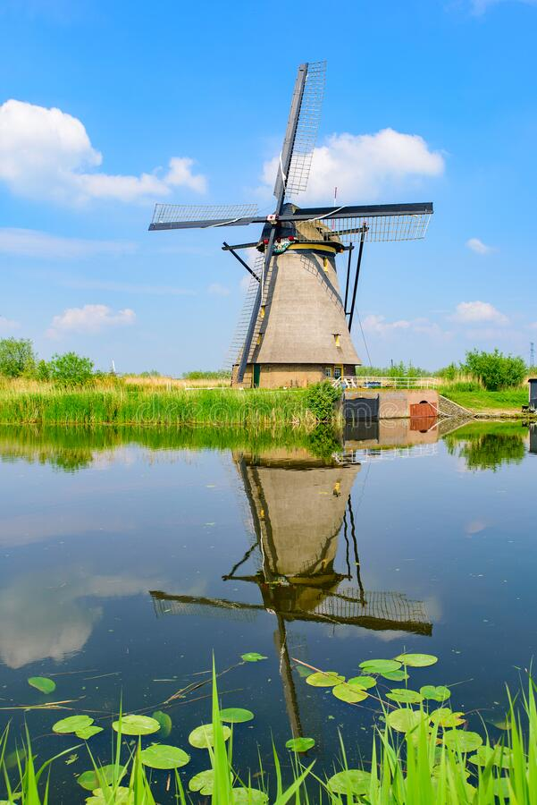 The windmills and the reflection on water in Kinderdijk in Rotterdam, Netherlands. The windmills and the reflection on water in Kinderdijk, a UNESCO World stock images