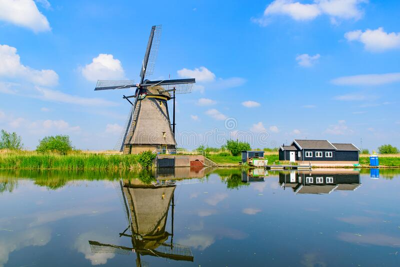 The windmills and the reflection on water in Kinderdijk in Rotterdam, Netherlands. The windmills and the reflection on water in Kinderdijk, a UNESCO World stock image