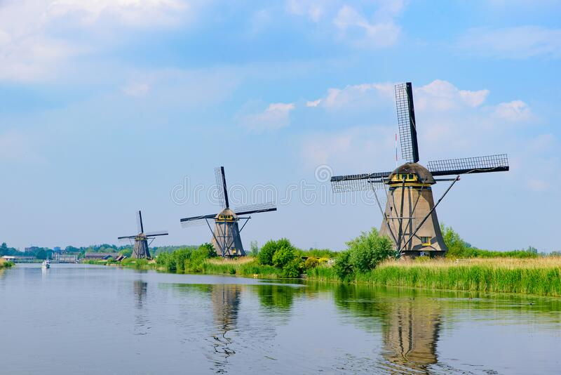 The windmills and the reflection on water in Kinderdijk in Rotterdam, Netherlands. The windmills and the reflection on water in Kinderdijk, a UNESCO World royalty free stock images