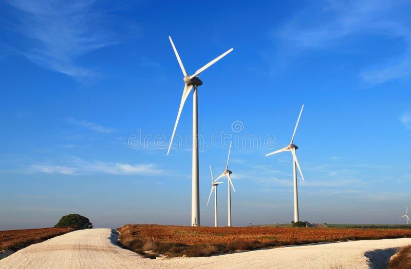 Windmills on the road stock photo