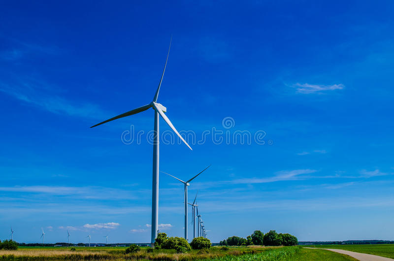 Windmills in a row from the ground royalty free stock photography