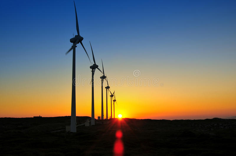 Windmills in the sunset. Sky energy environments stock images