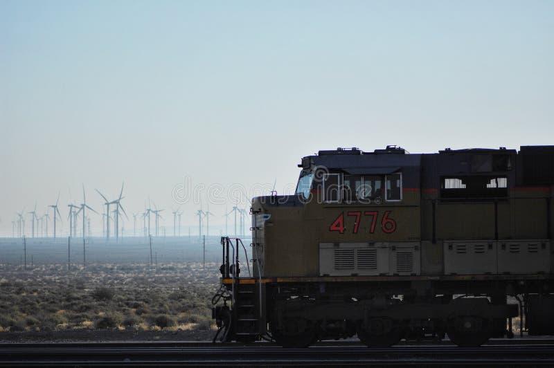 Windmills and train stock image