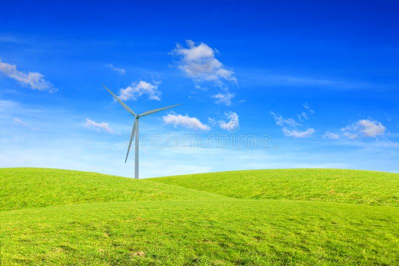 Windmils, hills and amazing sky. Green landscape stock photography