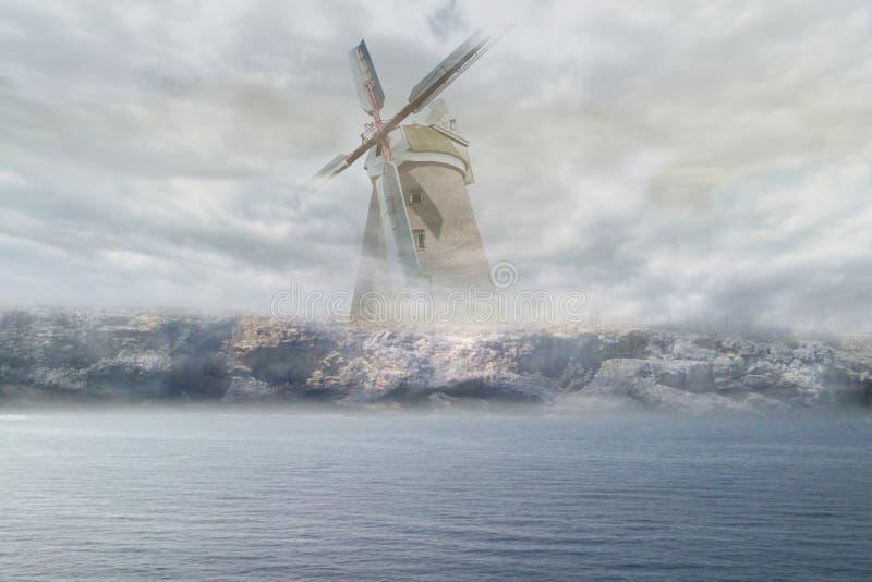 Windmolen in de mist stock afbeelding