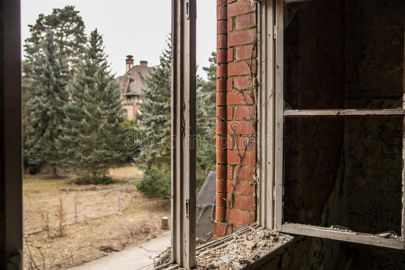 Window at abandoned hospital and sanatorium Beelitz Heilstätten near Berlin royalty free stock image