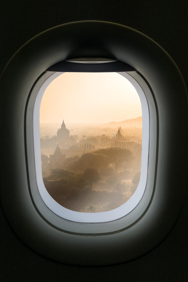 The window of airplane with travel destination attraction. Myanmar attraction. stock image