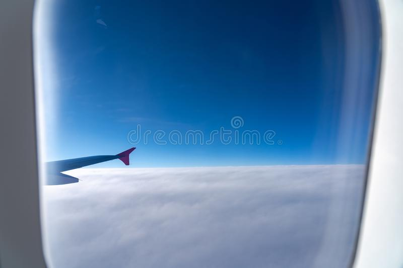 The window of the airplane. A view of porthole window on board an airbus for your travel concept royalty free stock photo
