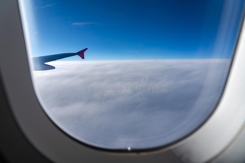 The window of the airplane. A view of porthole window on board an airbus for your travel concept. Or passenger air transportation royalty free stock photo