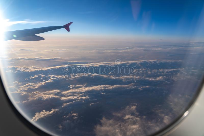 The window of the airplane. A view of porthole window on board an airbus for your travel concept. Or passenger air transportation royalty free stock image