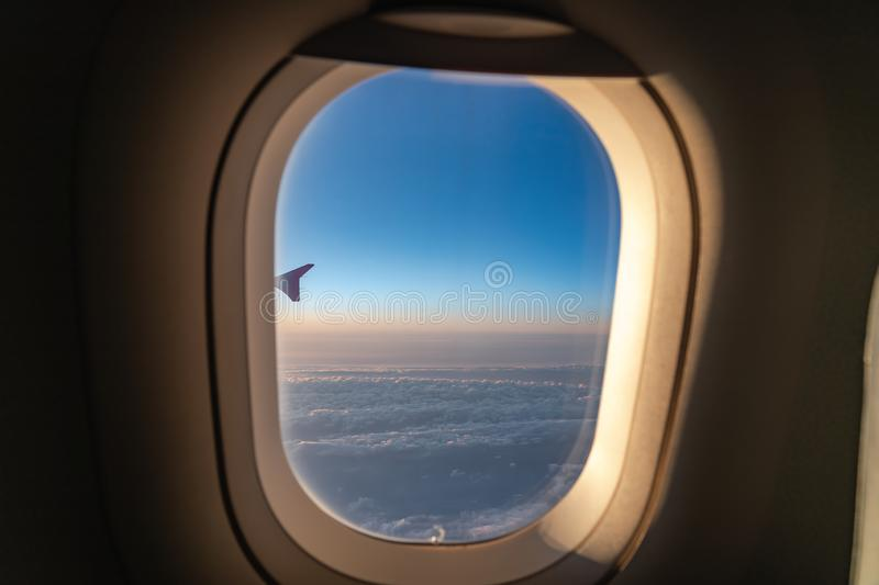 The window of the airplane. A view of porthole window on board an airbus for your travel concept. Or passenger air transportation stock photo