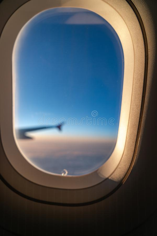 The window of the airplane. A view of porthole window on board an airbus for your travel concept. Or passenger air transportation stock photos