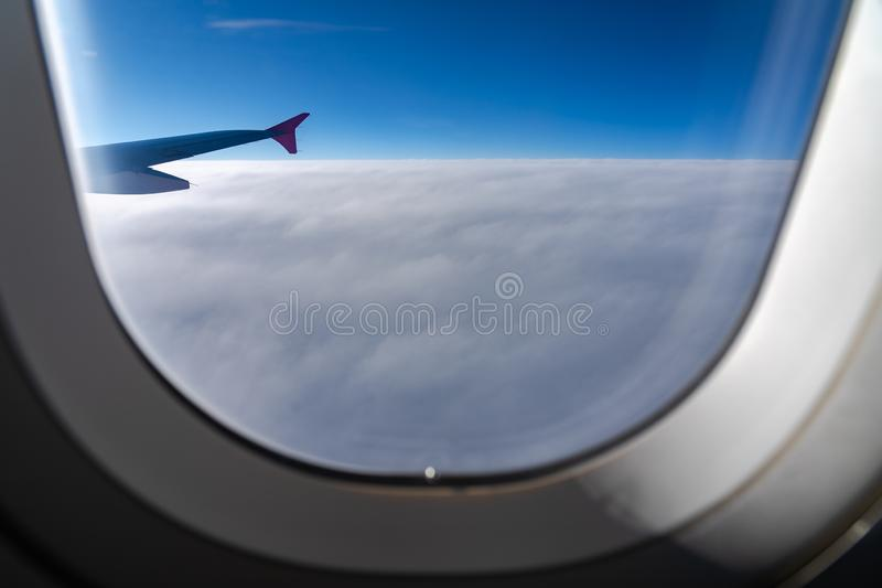 The window of the airplane. A view of porthole window on board an airbus for your travel concept. Or passenger air transportation stock image