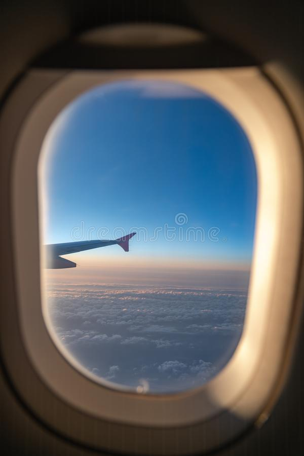 The window of the airplane. A view of porthole window on board an airbus for your travel concept. Or passenger air transportation royalty free stock photography