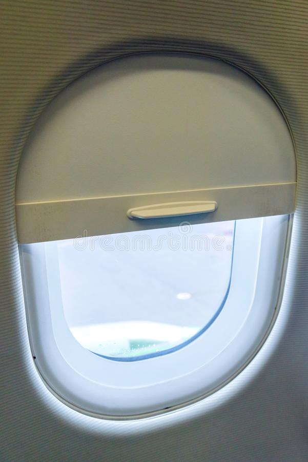 The window of the airplane. A view of porthole window on board an airbus for your travel concept or passenger air transportation stock photos