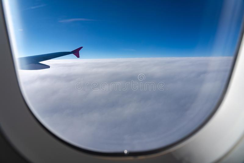 The window of the airplane. A view of porthole window on board an airbus for your travel concept or passenger air transportation royalty free stock images
