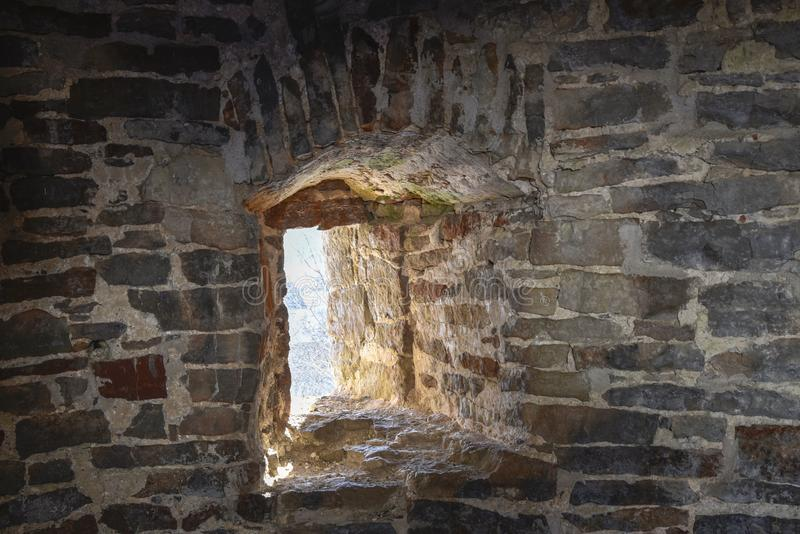 A window into an ancient brick wall. Old history medieval royalty free stock image