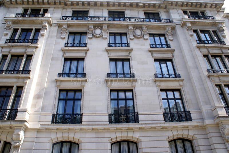 Window balconies. Facade details of window balconies, corbels, and cornice stock photos