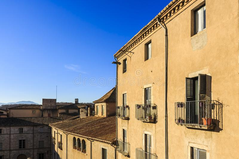 Window balconies with potted plants at Cathedral Square, Girona. Metal window balconies with potted plants at Cathedral Square, Girona stock image
