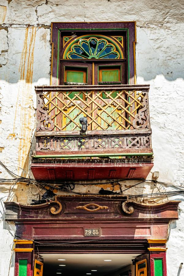 Facade of the old colorful colonial house in Marinilla, Colombia. Window with a balcony in old colorful colonial house in Marinilla, Colombia royalty free stock photo