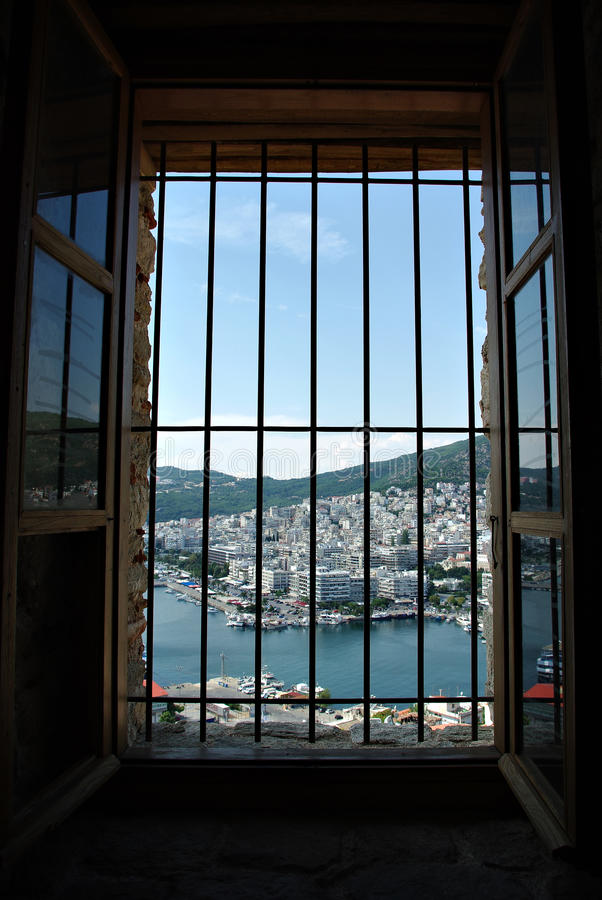 Through Window Bars. City panorama through window bars, white buildings and blue sky stock photography