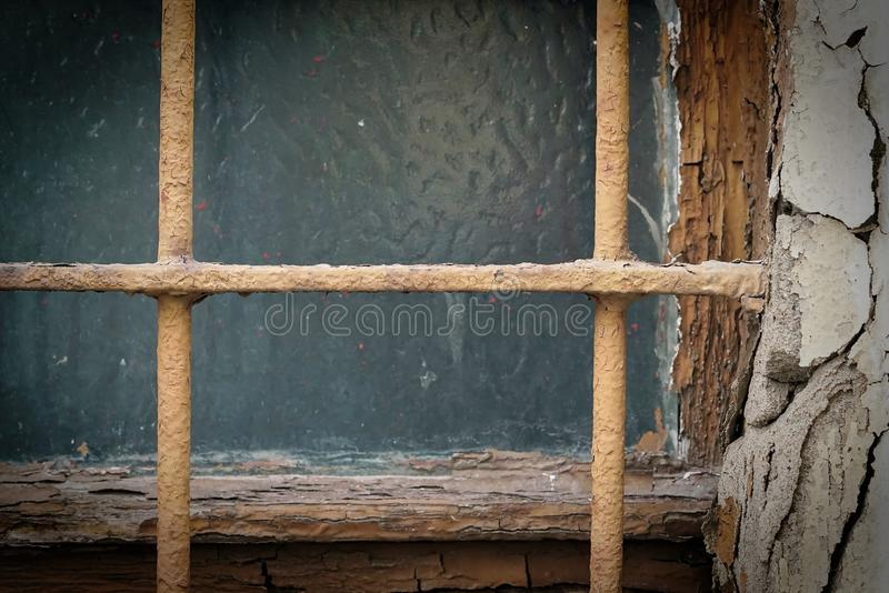 Window with window bars on a rundown house. In Magdeburg in Germany stock image