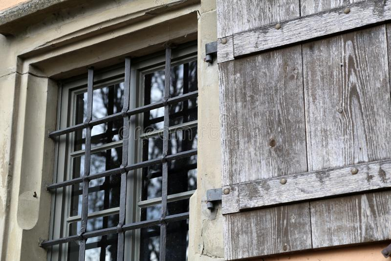 A window with bars and shuttered in the old Castle.  royalty free stock image