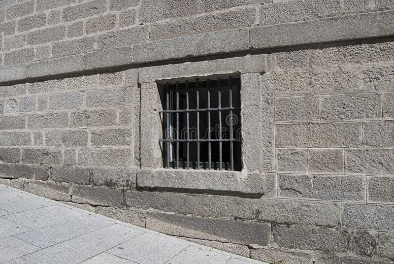 Window with bars on stone wall royalty free stock images