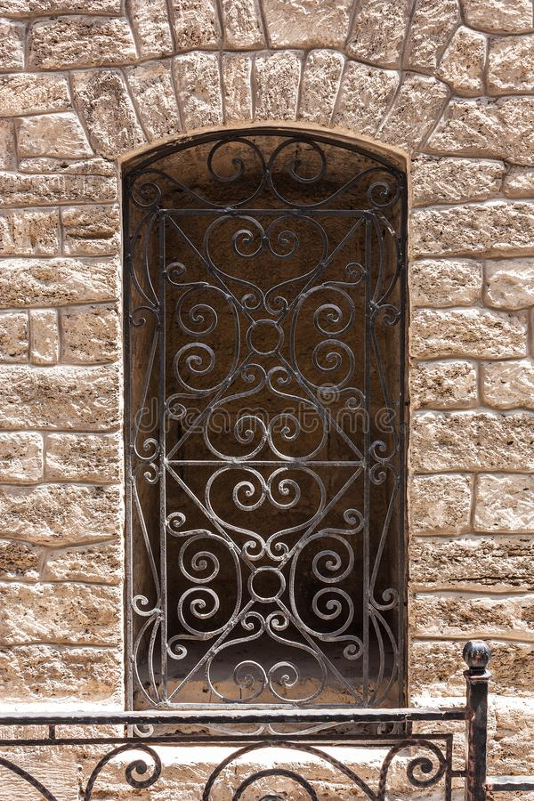 Window with bars in the wall of the old building. Icheri Sheher. Baku, Azerbaijan. 2018. Window with bars in the wall of the old building. Icheri Sheher. Baku royalty free stock photography