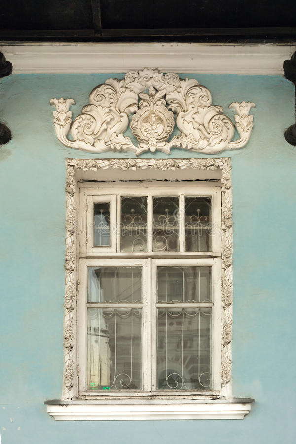 Window with bas-reliefs and molding in antique style royalty free stock photo