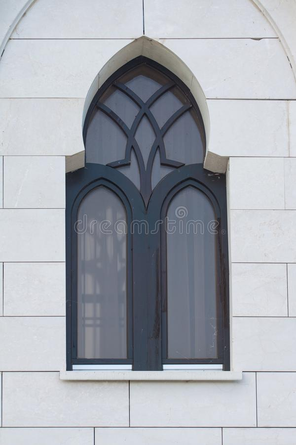 Window in a black frame on a white wall. royalty free stock image