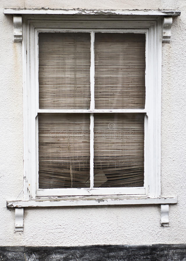Window and blind. A closed blind in the window of a house royalty free stock images