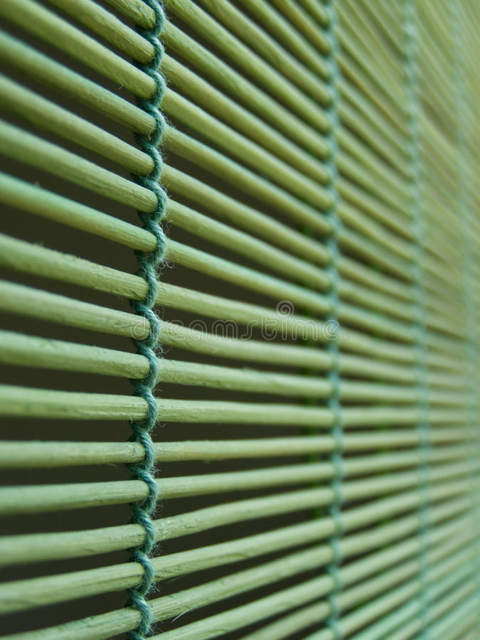 Window blinds. Interior detail, shallow depth of field (shallow DOF) on green bamboo window blinds, abstract *RAW format available at request royalty free stock image
