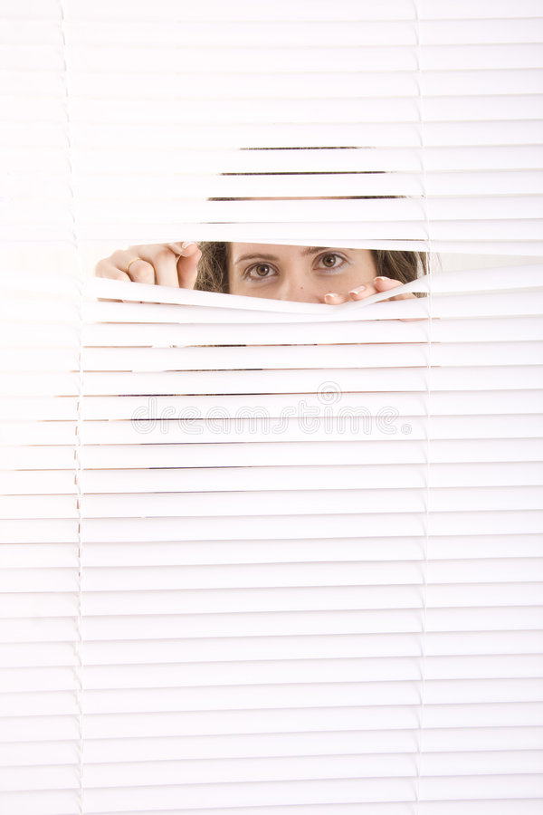 Window blinds. Hands apart on the window blinds royalty free stock images