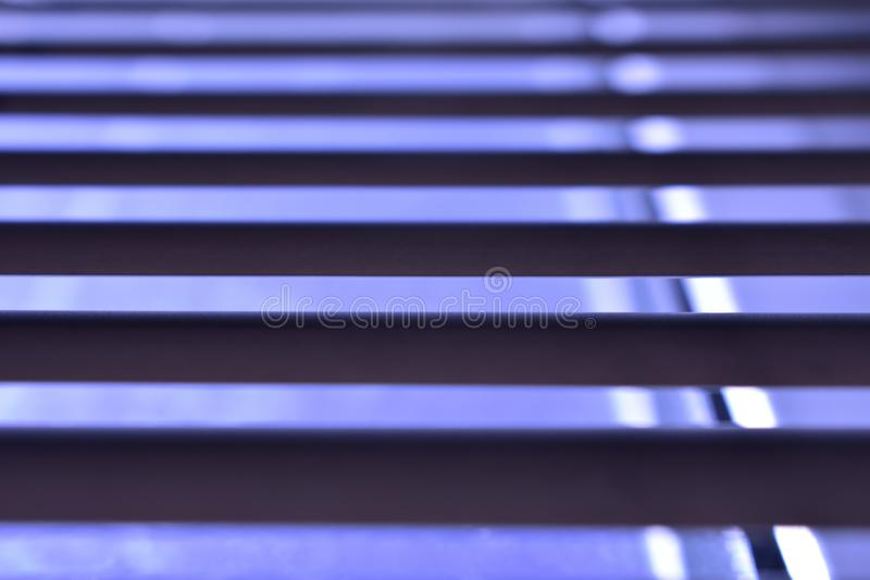 Window blinds, half open. You will see the blue sky and part of the window. Small depth of field. There`s room for your text. The texture of the louver which royalty free stock images