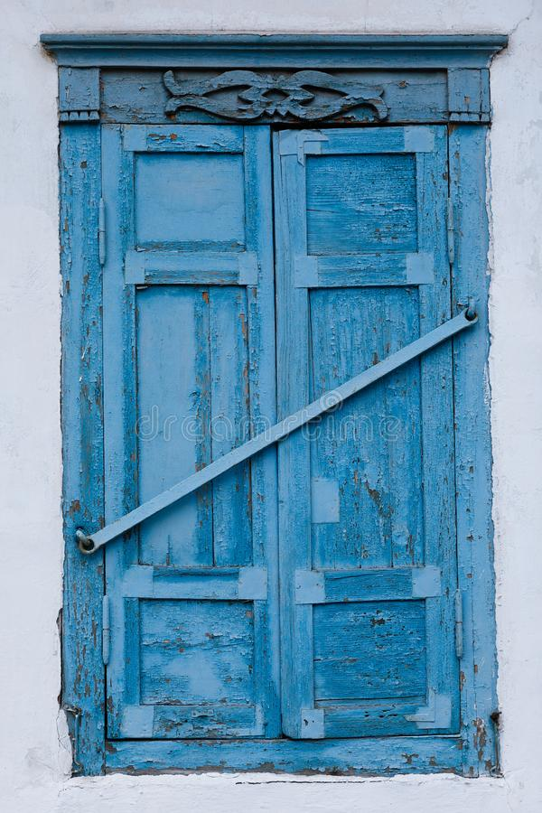 Window with blue shutter stock images