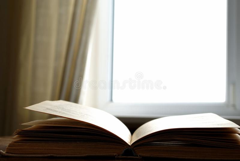 Window and the book stock images