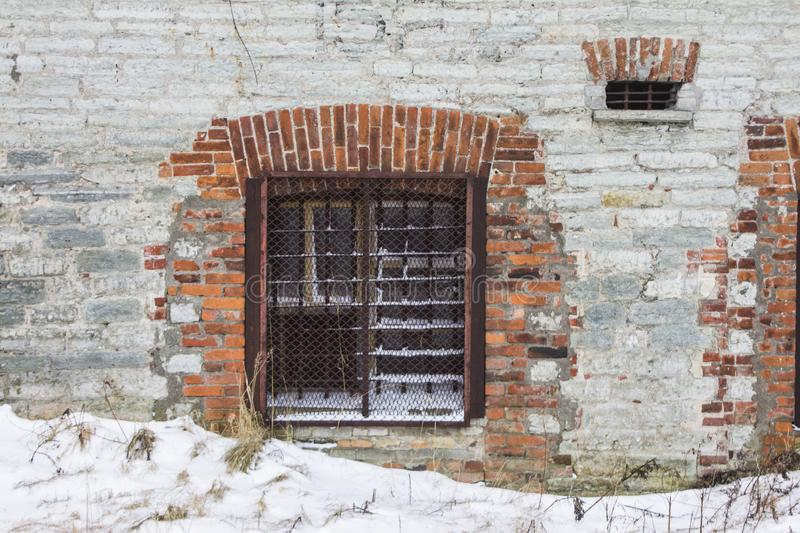 Window in the brick wall of the Battery Prison in Tallinn in winter. Estonia.  stock photography