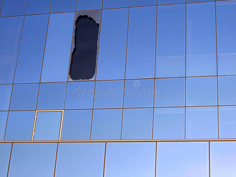 Window broken by impact stock image