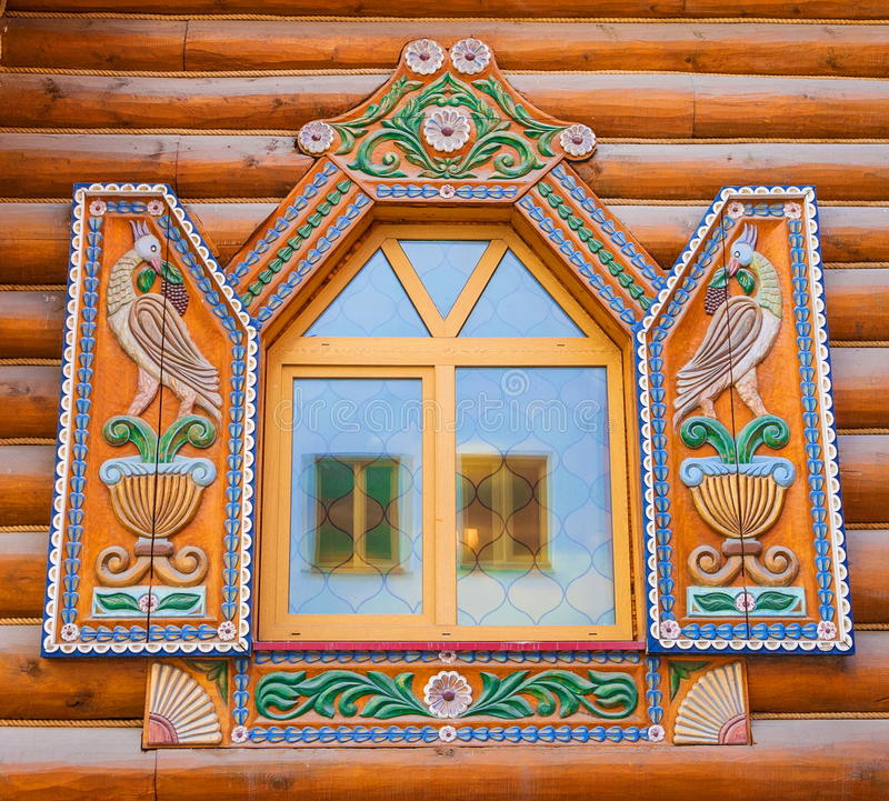 Window with carved shutters. Window of the log house with carved shutters stock photos