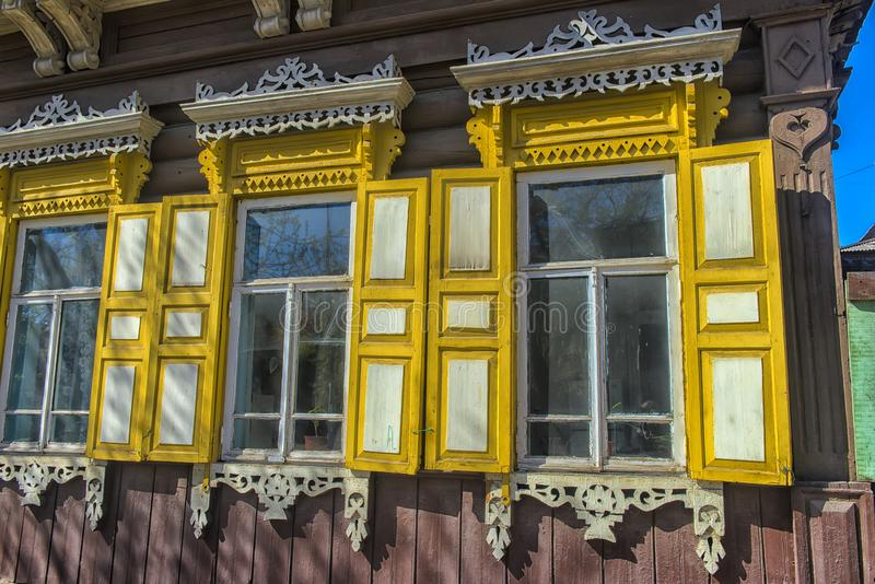 Window with carving architraves and closed shutters. Irkutsk streets, Russia stock photography