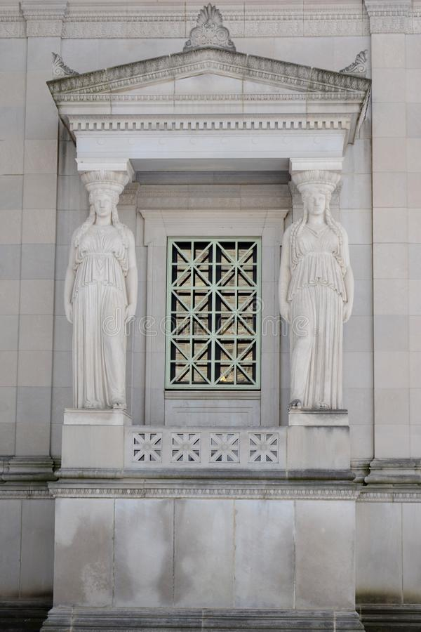 Window Caryatids In Chicago. This is a Winter picture of a Pair of caryatids on the North wall of the Museum of Science and Industry located in Chicago, Illinois stock photo