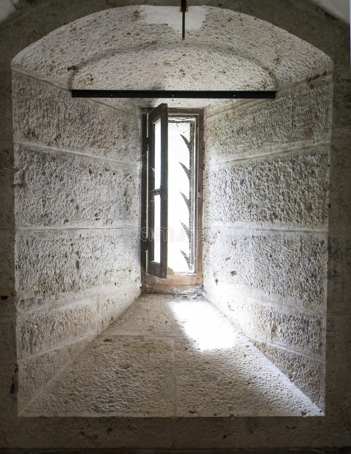 Window in Chaumont Chateau. Narrow slit window with defensive spikes located in the basement of Chaumont Chateau France stock image