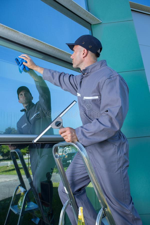 Window cleaner at mall royalty free stock photography
